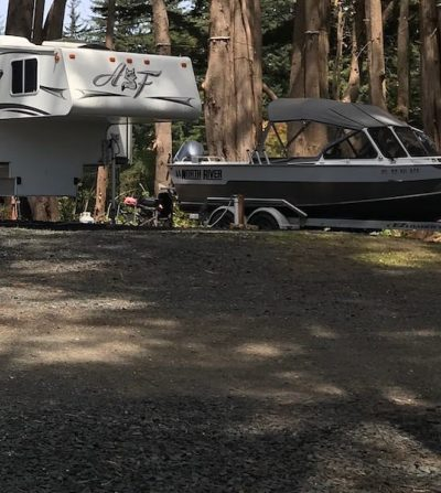 Camper and boat in RV park