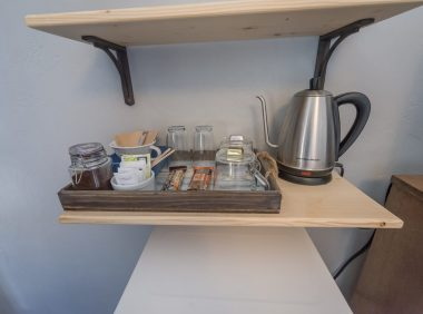 Coffee perculator and snacks on shelf