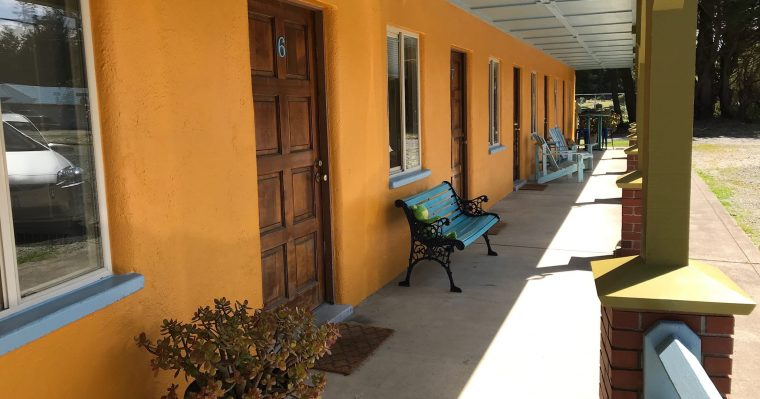 Porch of motel with chairs for relaxing